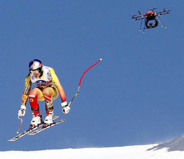 A TV drone flies beside Canada's Erick Guay during the second practice of the men's Alpine skiing World Cup downhill race at the Lauberhorn in Wengen, January 12, 2012. Reuters